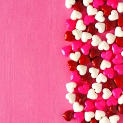 Valentines Day candy border on a pink paper background