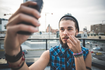young handsome bearded hipster man selfie