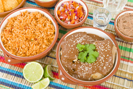 Mole Poblano - Chicken with mole sauce and side dishes.