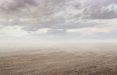 Gravel background with gravel mist and clouds in sunset