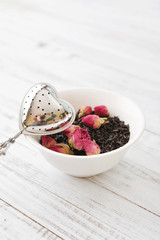 Tea strainer and rose buds