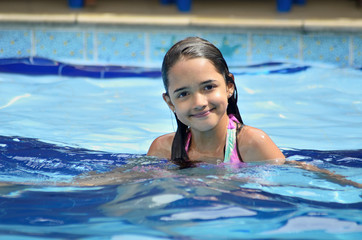 Little Hispanic Girl in the Swimming Pool
