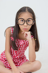 Portrait of little Asian child wearing glasses