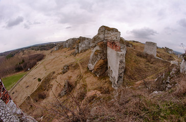 rocks and ruined medieval castle in Olsztyn, Poland.