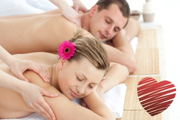 Composite image of relaxing couple having a massage