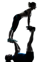 Wall Mural - man woman exercising acrobatic workout fitness silhouette