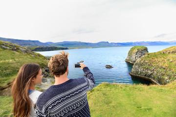 Tourists on travel taking photo on Iceland