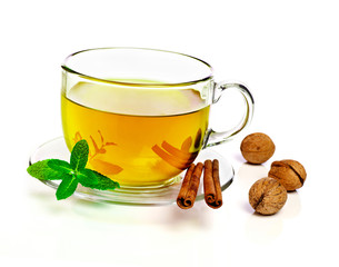Cup of tea with cinnamon and nuts