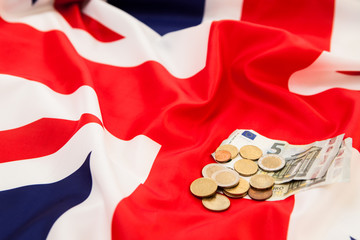 A small fee on the background of the flag of the United Kingdom
