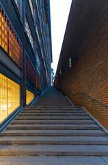 Steps leading up a dark modern alleyway