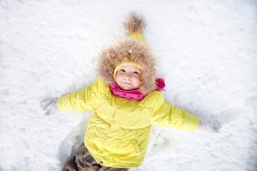 Little girl lying on snowLittle girl lying on snow
