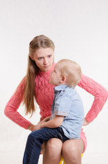 Young mother is angry at three year old bo