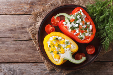 Fresh peppers stuffed with cottage cheese top view horizontal