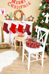 Beautiful Christmas interior with sofa, decorative fireplace