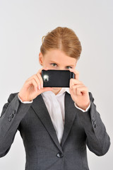 Woman using smartphone as a photocamera
