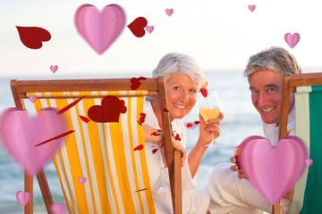Composite image of senior couple drinking a cocktail