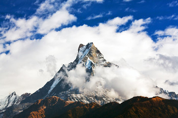 Wall Murals Nepal Machapuchare mount over clouds, Nepal