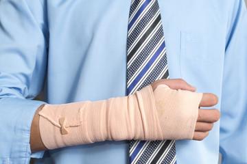 Hand injured businessman , insurance concept