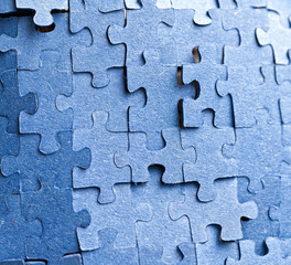 Real photograph of the backside of blue puzzle jigsaw