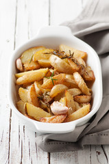 Cooked potatoes with rosemary, garlic and lemon, selective focus