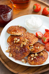 Breakfast with pancakes, fresh strawberries and cream, vertical