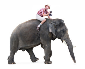 cheerful tourist rides on an elephant carrying a camera