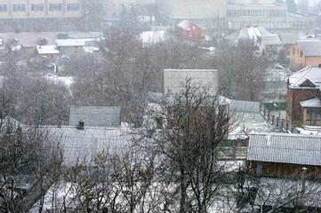 Heavy snowfall on a city street