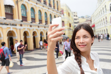 Woman tourist taking selfie pictures in Macau