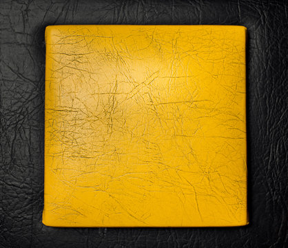 Texture of black leather with yellow leather insert.