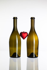 Empty bottles of wine and love symbol