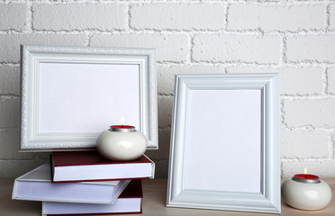 Photo frames with candles and books