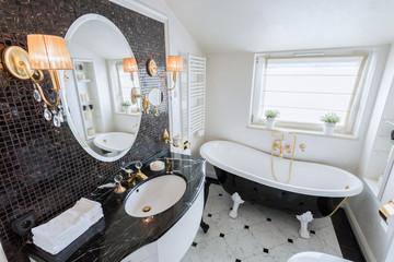 Bright bathroom in baroque style