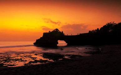 Tanah Lot temple in golden sunset, Bali , Indonesia