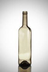 empty bottle of wine on a light background with reflection