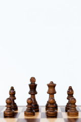 Chess wooden pieces and chess wood board on white background