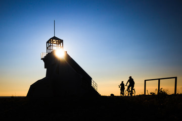 Bicyclist silhouette at Sunset Lighthouse