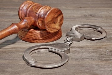 Handcuffs and Gavel in Courtroom