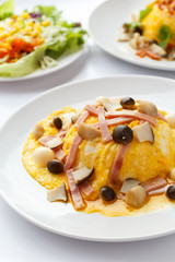 Creamy omelet with ham and mushroom.