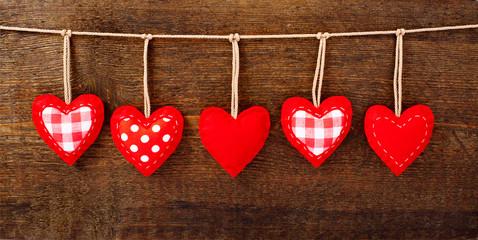 Valentines Vintage Handmade Hearts over Wooden Background.