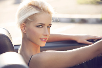 blond woman in cabrio