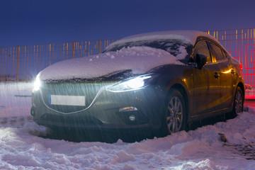 Car under heavy overnight snowfall, Poland