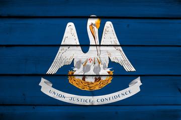 Louisiana State Flag on wood background