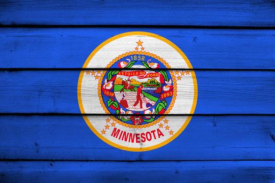 Minnesota State Flag on wood background