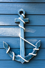 Old blue wooden wall anchor