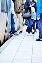 Passengers departs commuter train