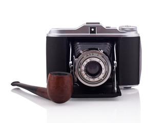 Vintage camera and smoking pipe