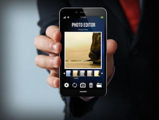 businessman with photo editor smartphone