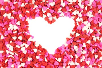 Heart shape within Valentines Day candy heart background
