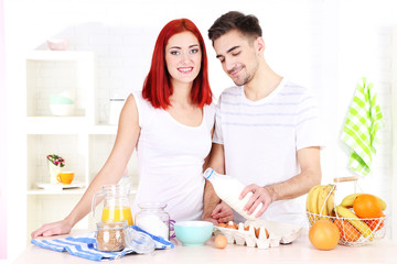 Happy couple preparing dough baking in kitchen