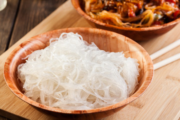 Bowl of rice noodles on table